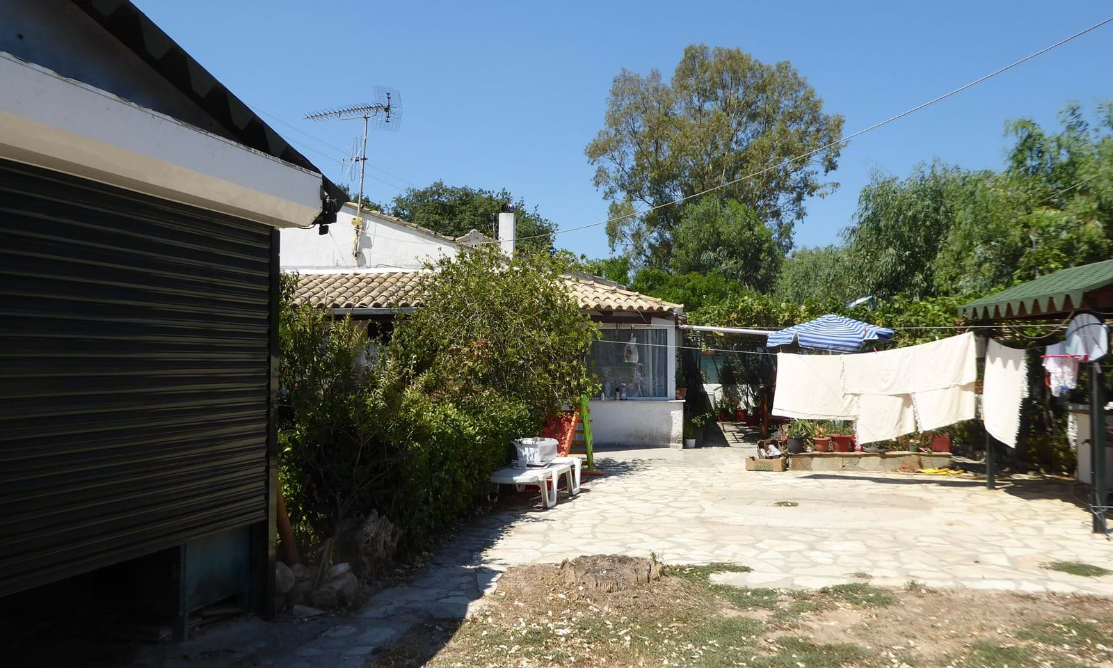 Beach side house for sale in Corfu