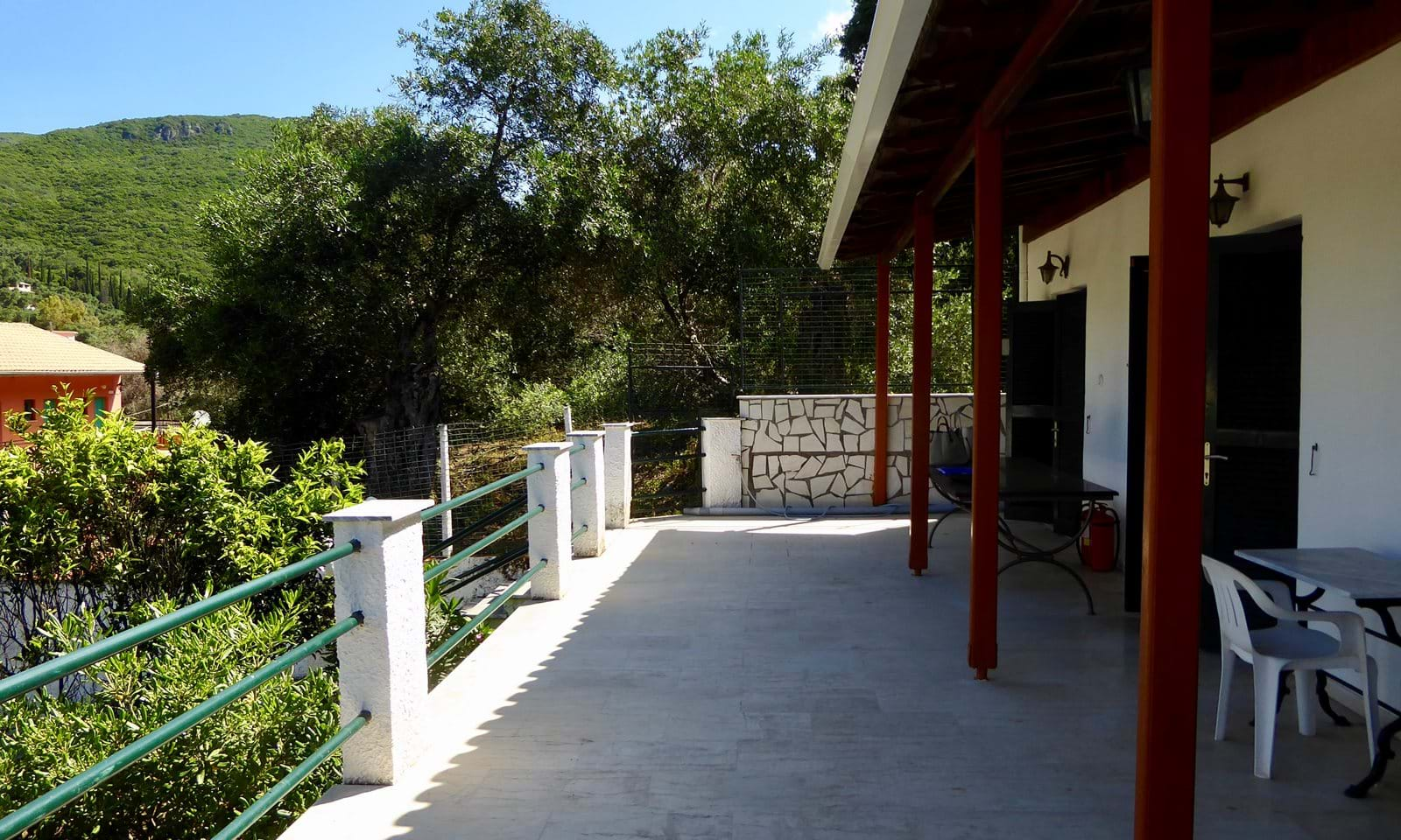 Covered veranda at the front side of the house