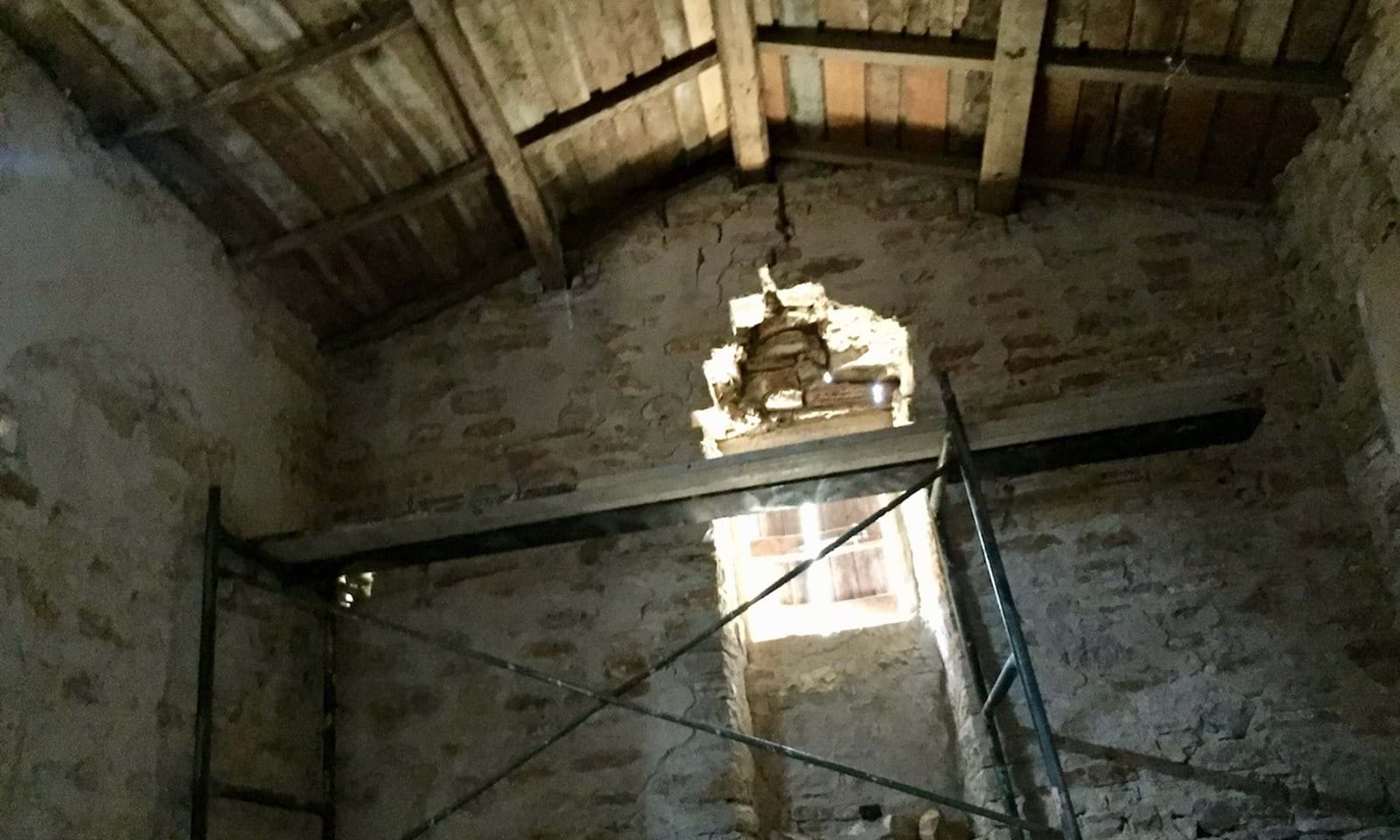 Inside the smaller room of the Olive Press, hight ceiling