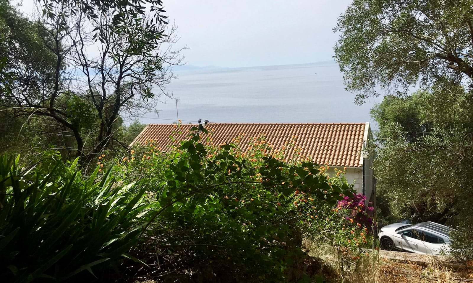 The property in front of the plot, and the sea view