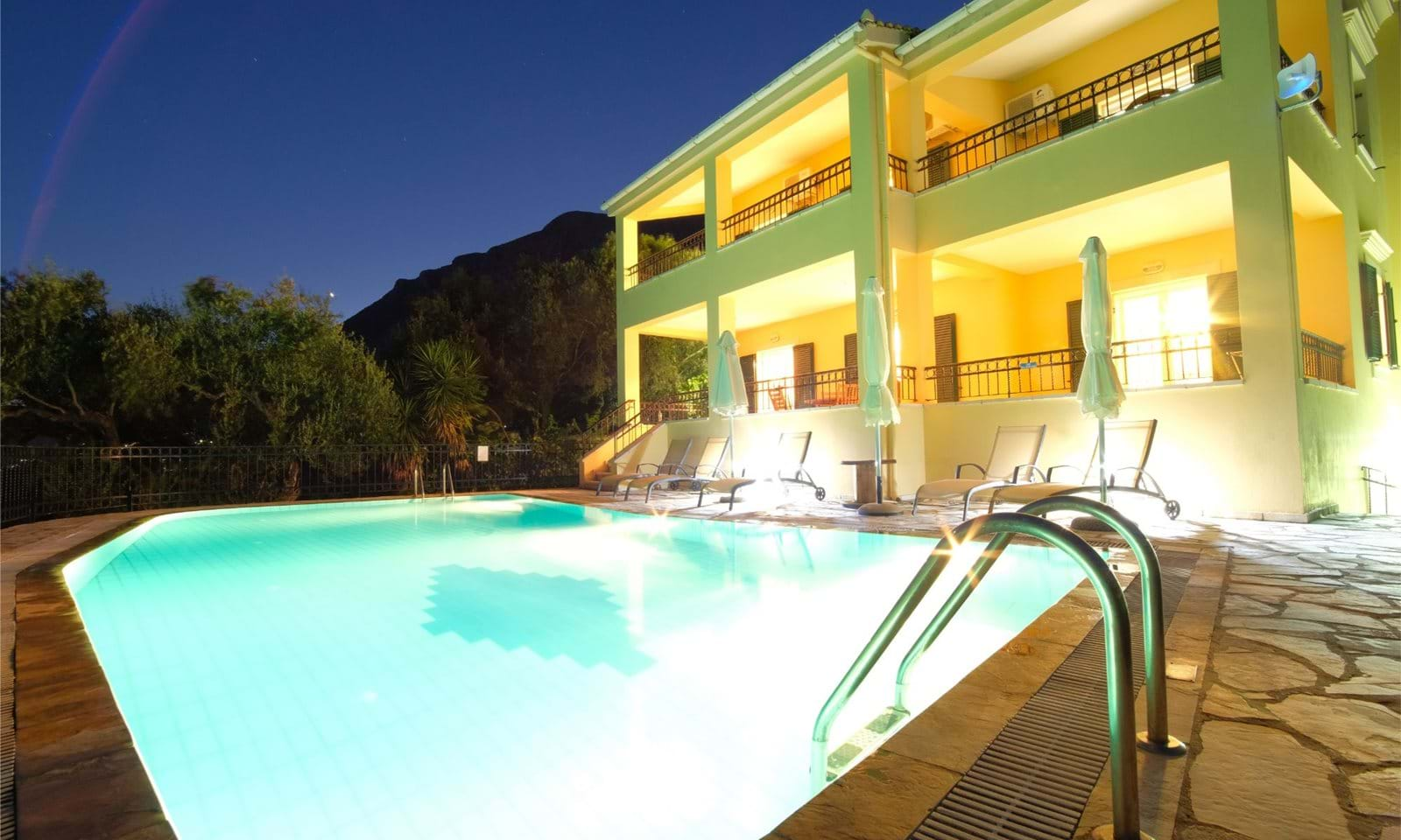 Villa and swimming pool at night